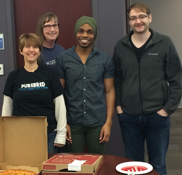 Seapine's Technical Support team (L to R: Jeni, Trish, Brandon, and Shane) get ready to enjoy their pizza.